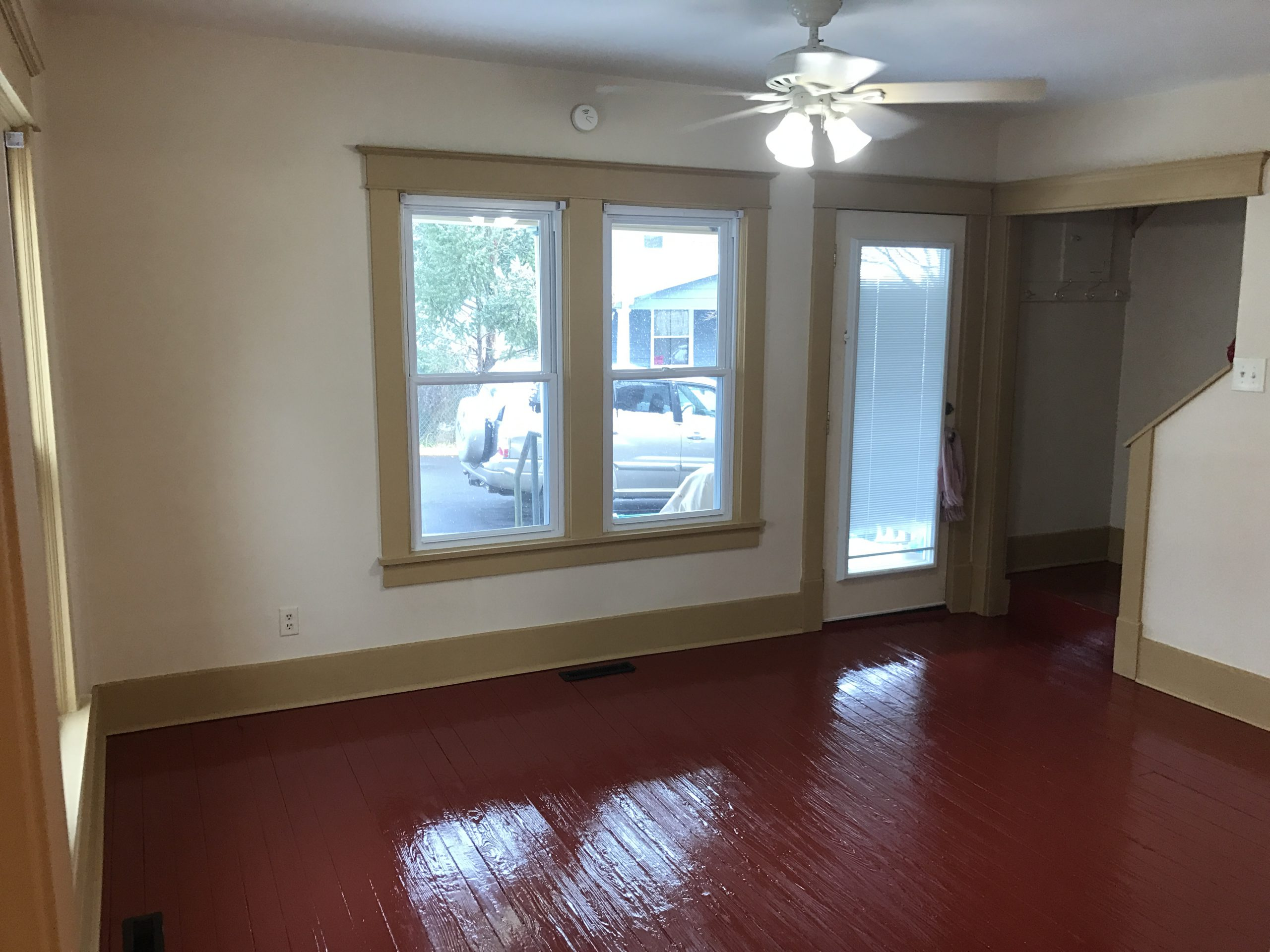 living room view with windows and front door